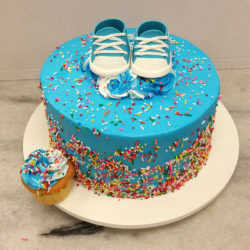 Blue cake with baby shoes