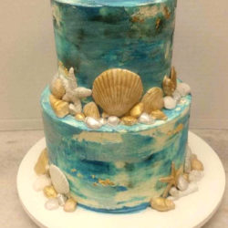 Marbled ocean themed cake with sea shells