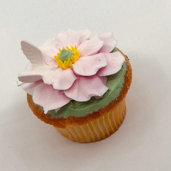 Eloise with Dove flower cupcake