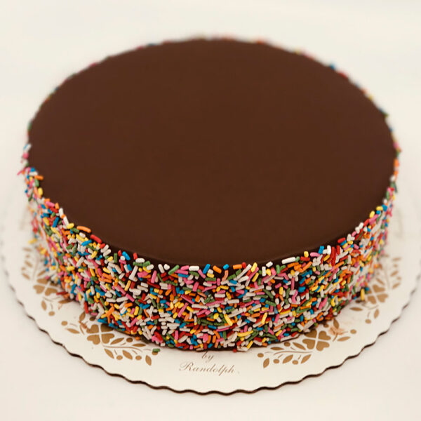 multi-colored sprinkles on chocolate buttercream