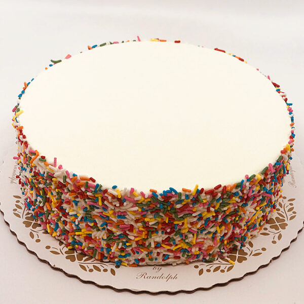 multi-colored sprinkles on vanilla buttercream