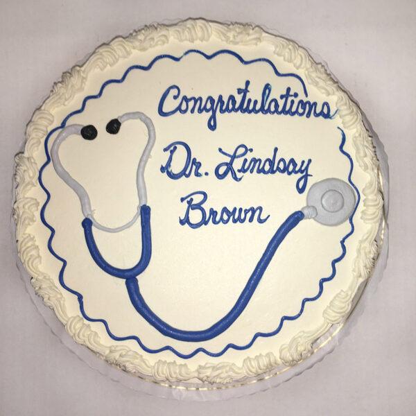 Graduation cake with stethoscope and writing