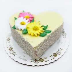 Heart shaped spring bouqet buttercream cake