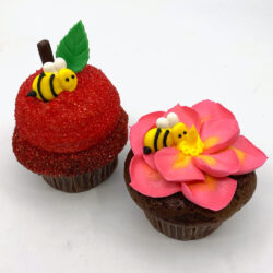 Rosh Hashanah cupcakes with bee, apple, and flowers